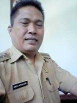 Camat Touluaan Arnold Mokosolang MM